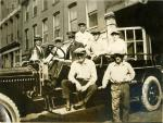 di49240 - Young men on a fire truck