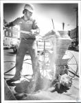 di55385 - Bob Heiland (29) doing concrete work at 7th ...