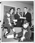 di57567 - Mr. and Mrs. Robert Arnold (left) and Joe ...