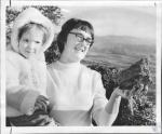 di64521 - Mrs. Molly McEntee and baby Laura with rock ...