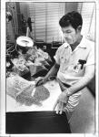 di64625 - Bill Tobergte, bacteriologist checking malted ...
