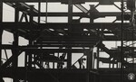 di97009 - Iron worker pounds away with his hammer as ...