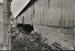 di97071 - Wall at Duro Bag where the rain blew it out.