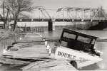 di98845 - Bridge construction site, and an old boat ...
