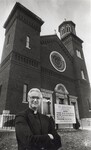 di99045 - Msgr. Donald Hellmann in front of his old ...