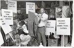 di99063 - Earl Hinte Jr. sorts through some clothing ...