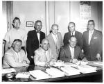 kcpl046074020 - Ralph Mussman with group of people signing ...